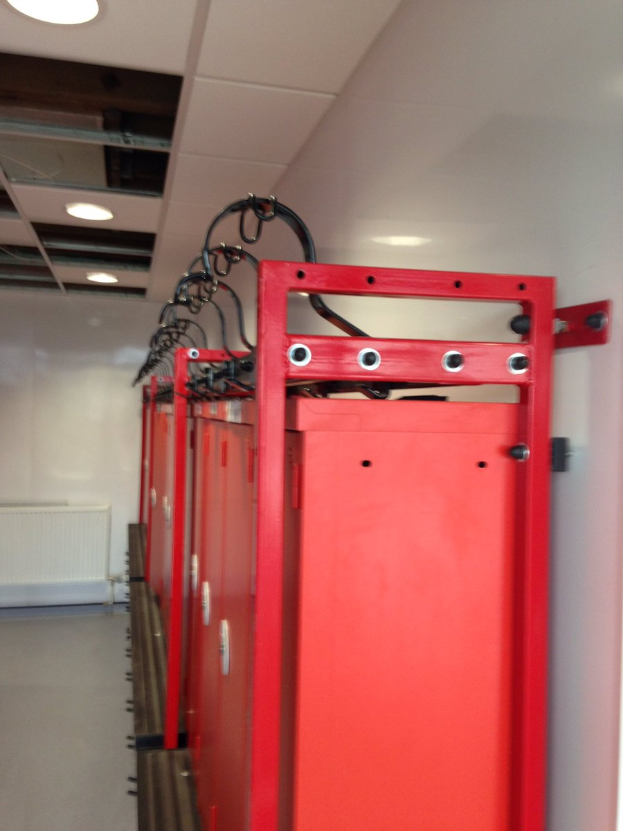 Firefighters muster room kit racking system for 42 firefighters, Designed & installed by Paul Haskell - fort welded systems, Brynmawr. Powder coated using Thermaset Ral 3000 gloss (TLP-7210-G) by PPS Powder Coating. #PowderCoating #Manufacturing #MadeInBritain