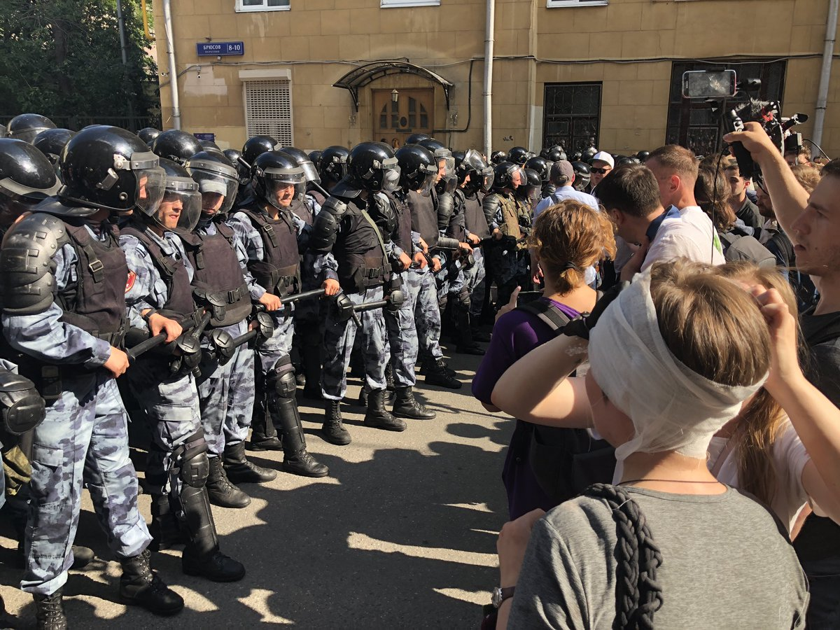 Riot police and protestors face off in Moscow. #cnn #russia #moscow