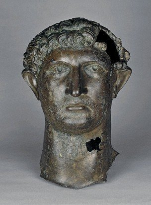 This rare and beautiful bronze head of Hadrian, once part of a larger sculpture, was dredged up from the bed of the Thames near London Bridge in 1834. The statue was possibly erected in Londinium to commemorate the emperor's visit to Britannia in 122CE. Now in the @britishmuseum.<br>http://pic.twitter.com/4HQhRDvRzU