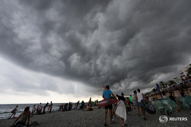 The skies looked like something seen in a disaster movie. When I arrived at the beach, people were fleeing with their belongings. It was bizarre to see the beach empty during the summer holiday season on the Promenade des Anglais. -- @Reuters photographer @EricGaillard06