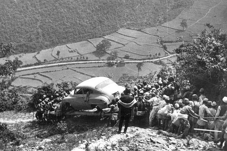 Men carrying car for the first time to Kathmandu back in 1948.