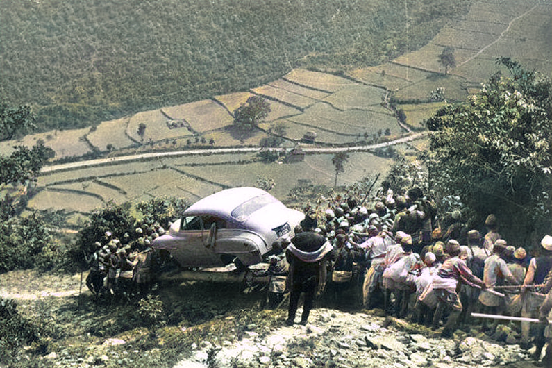 Men carrying car for the first time to Kathmandu back in 1948.Auto-colorized using #DeOldify.