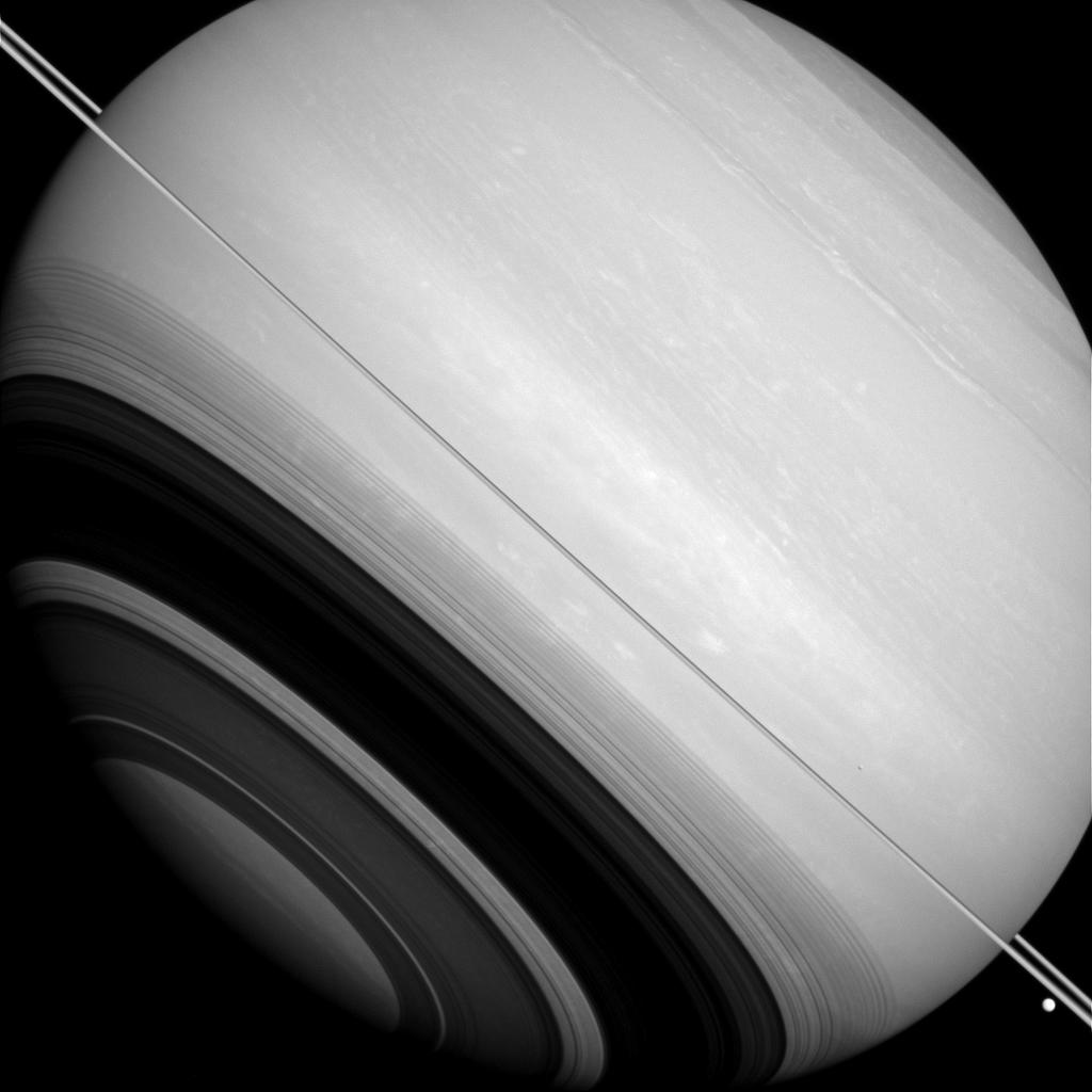 Five years ago today, Cassini captured this look at Saturn's rings casting intricate shadows. If you look closely, you might also spot two moons. Details: go.nasa.gov/2OWJfZs