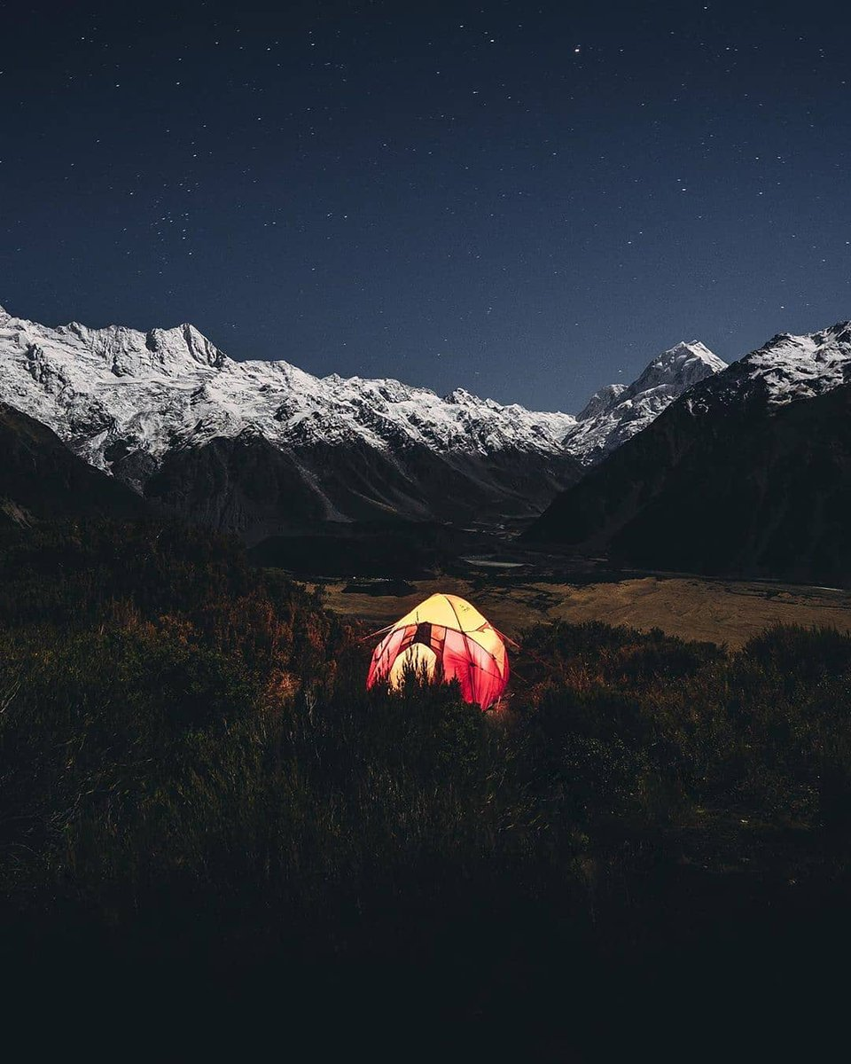 """#MeetTheWorld: """"When the full moon begins to rise and illuminates the highest peaks in the country that surround your campsite you can't help but get out of bed and snap some shots."""" 🏕️📸 : @ryan_domenico"""