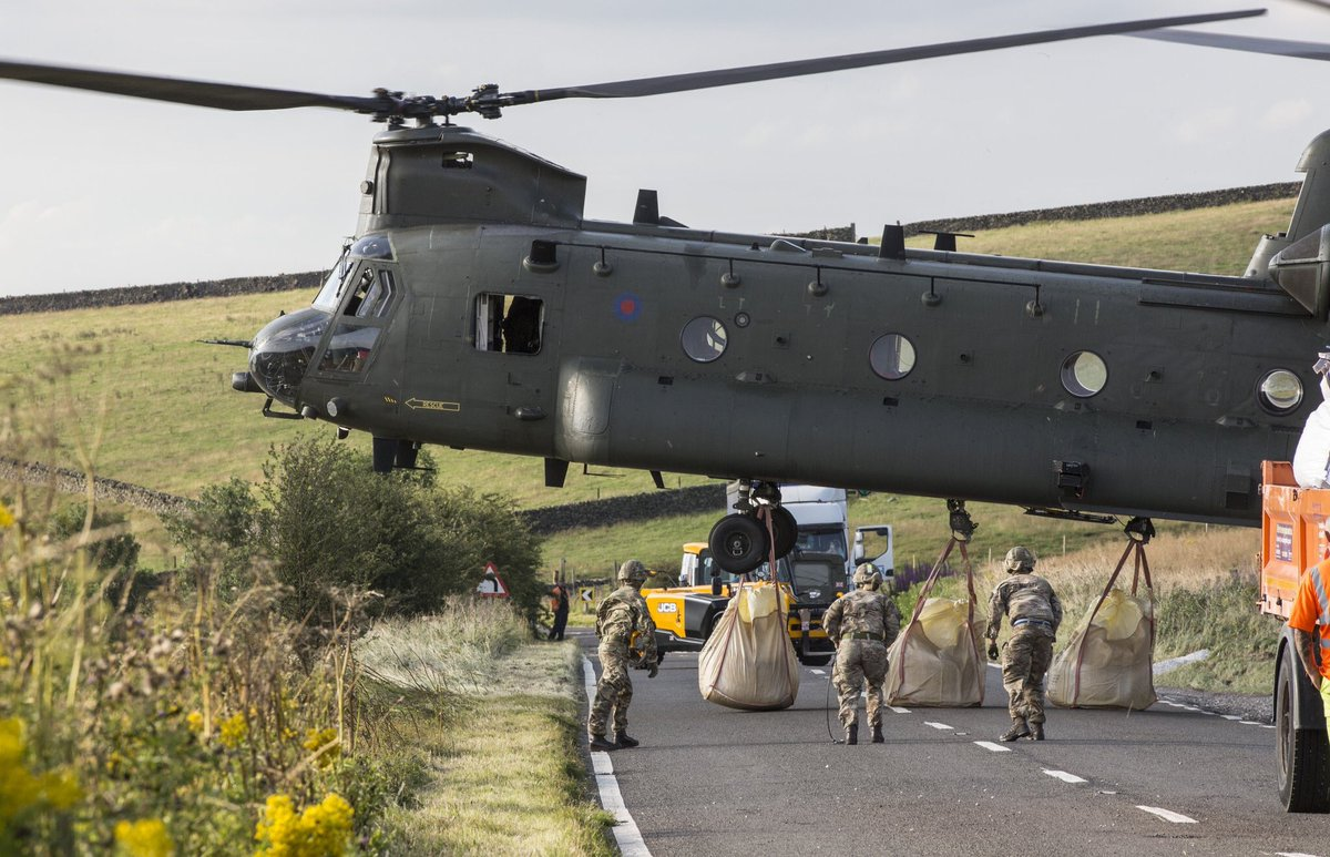 Army personnel continue to work alongside the RAF, emergency services and civil authorities supporting the flood relief effort at #WhaleyBridge. More than 400 tonnes of aggregate has been moved to help shore up the dam at Toddbrook Reservoir