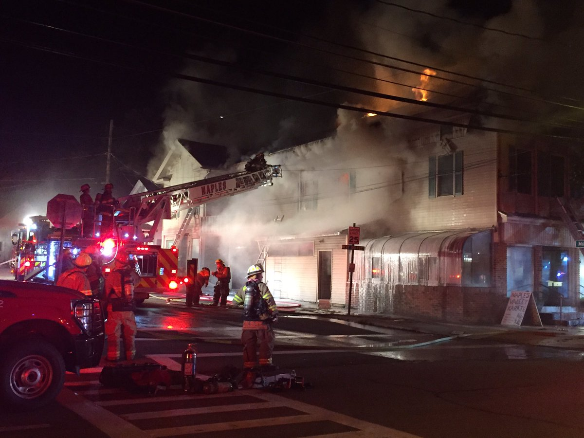 Structure fire tears through Main St. building in Naples