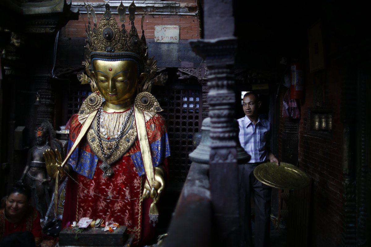 Devotees offer prayers to an idol of Deity Dipankar Buddha that are placed for prayers during Pancha Dan festival at Patan in Lalitpur, Nepal on Thursday, August 8, 2019.