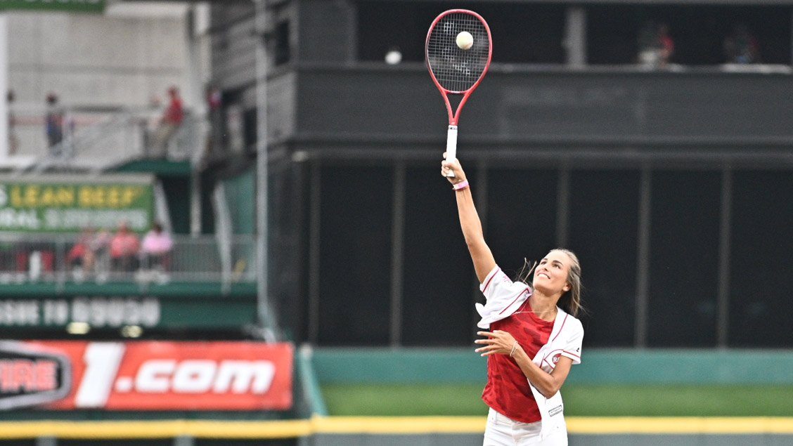 Monica Puig serves first pitch for Reds