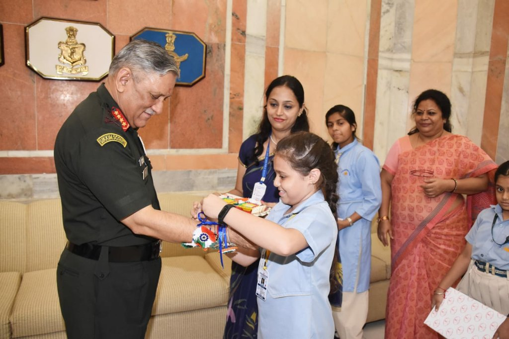 With children & their mentors. #RakshaBandhan2019 General Bipin Rawat #COAS celebrated Raksha Bandhan with school children of Delhi.  #IndianArmy #NationFirst https://t.co/gcKcL0KSOO