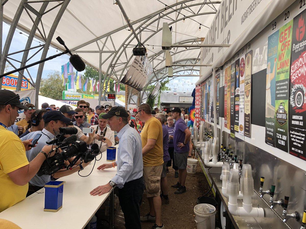 .@Hickenlooper is here and he's serving beer. #iacaucus #iowastatefair