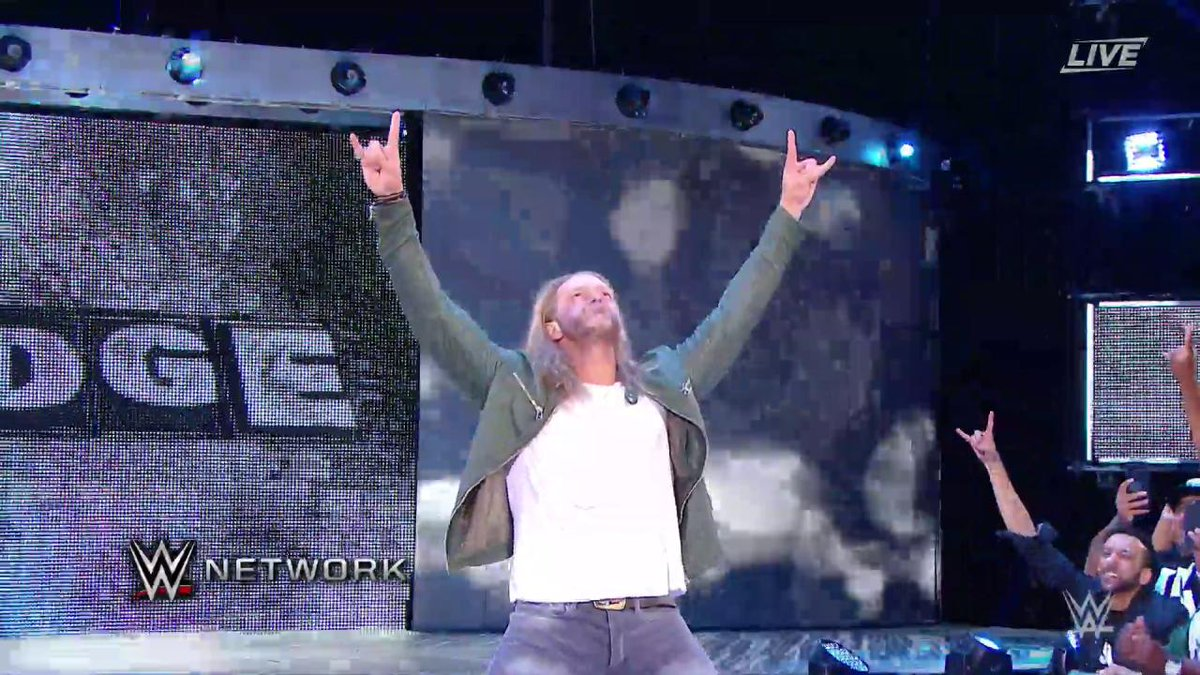 WHAT JUST HAPPENED?! @EdgeRatedR just surprised the entire @WWEUniverse at #SummerSlam!