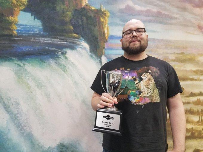 Justin Plocher holding his MagicFest Minneapolis trophy