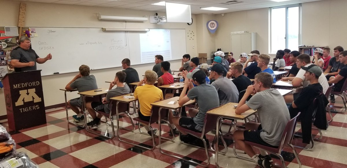 Medford football coach Jerome Johannes and the Tigers hold a classroom meeting on the first day of practice. #mshsl