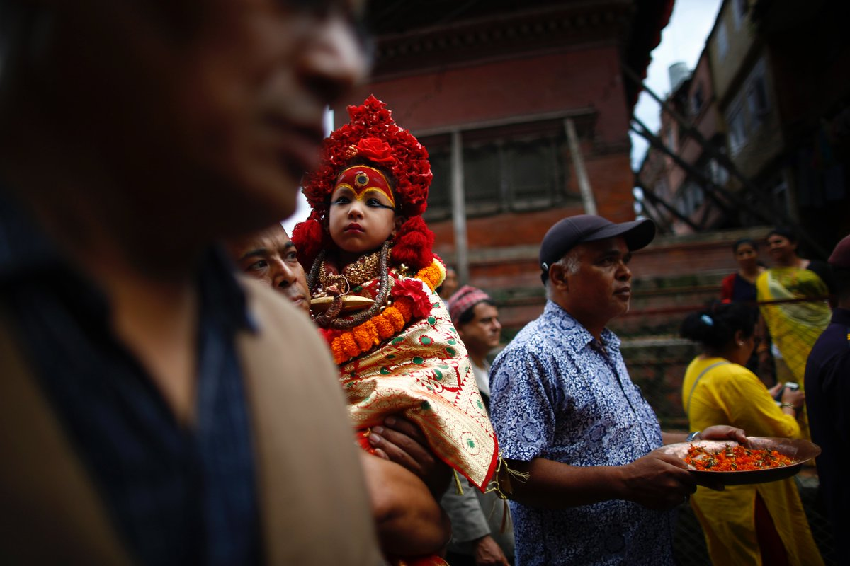 Nepal's Living Goddess Kumari is carried on a procession to observe the Changunarayan Kalash festival in Kathmandu, Nepal on Monday, August 12, 2019.