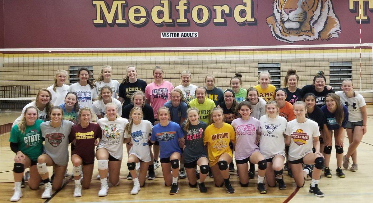 The Medford Tigers volleyball team ... in formal photo mode and 'do something silly' photo mode. #mshsl