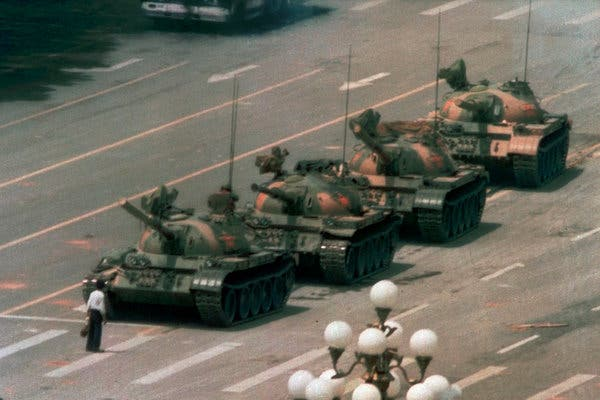 One man wore a white shirt and black trousers, and carried two shopping bags. He stared down a tank.The other wore shorts and a tank top, and carried a furled umbrella. He stared down a police officer who had a weapon drawn.  #China #DemonstrationsProtest https://t.co/ntnPSEv4Mm https://t.co/S4eCmFRvQK