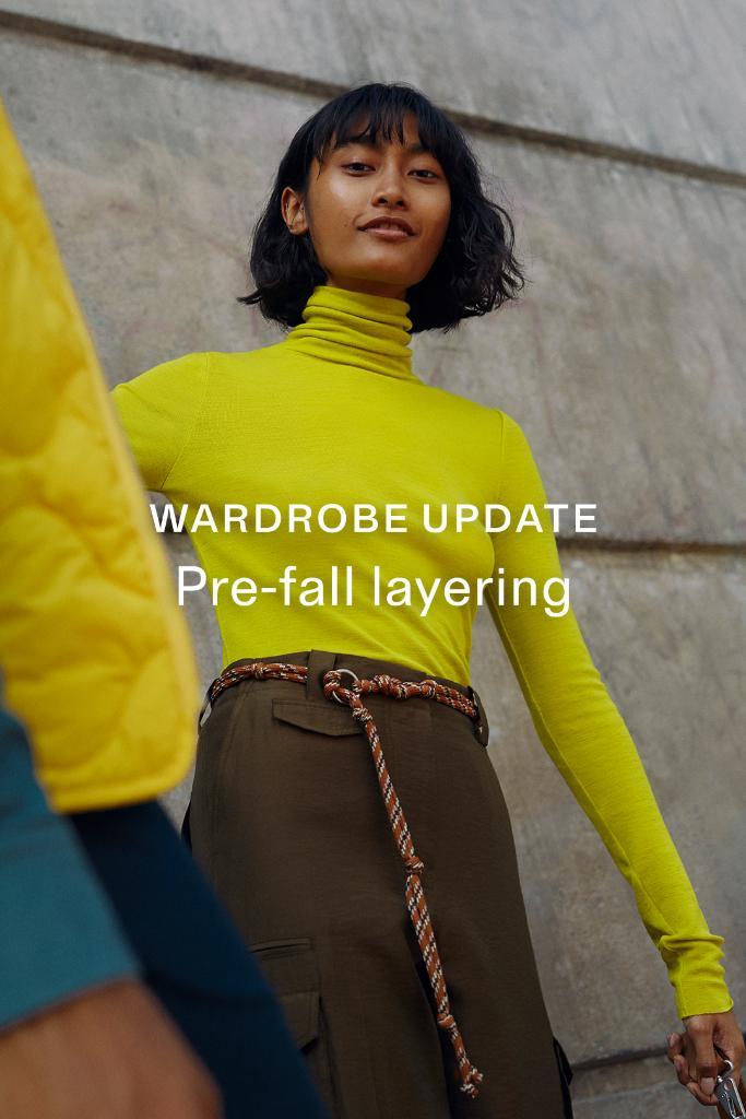 "Female model posing by a wall wearing lime green. Text overlay ""Wardrobe update line break Pre-fall styling"""