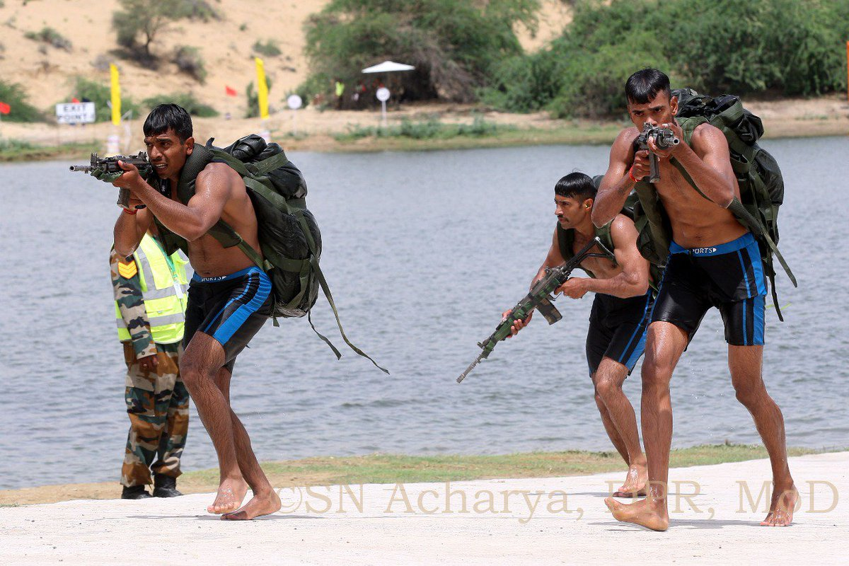 Stage-V   #Scout Trail Obstacle Specialist Course of #Fifth Edition of Army #ScoutMastersCompetition was conducted at #Jaisalmer #Rajasthan. It involved crossing of 150 meters water obstacle with #Arms and equipment.  #IndianArmy https://t.co/DIerpFbA1O