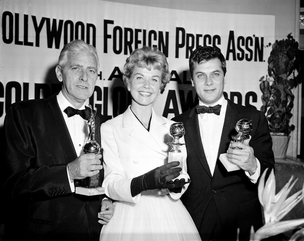 Doris Day, Tony Curtis and Buddy Adler pose with their awards presented to them by the Hollywood Foreign Press Association at its annual awards dinner in the Cocoanut Grove in Los Angeles, Ca., Feb. 26, 1958. <br>http://pic.twitter.com/gCsgJ1cshR