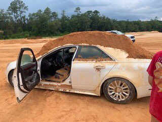 Florida man covers his girlfriend's car with sand