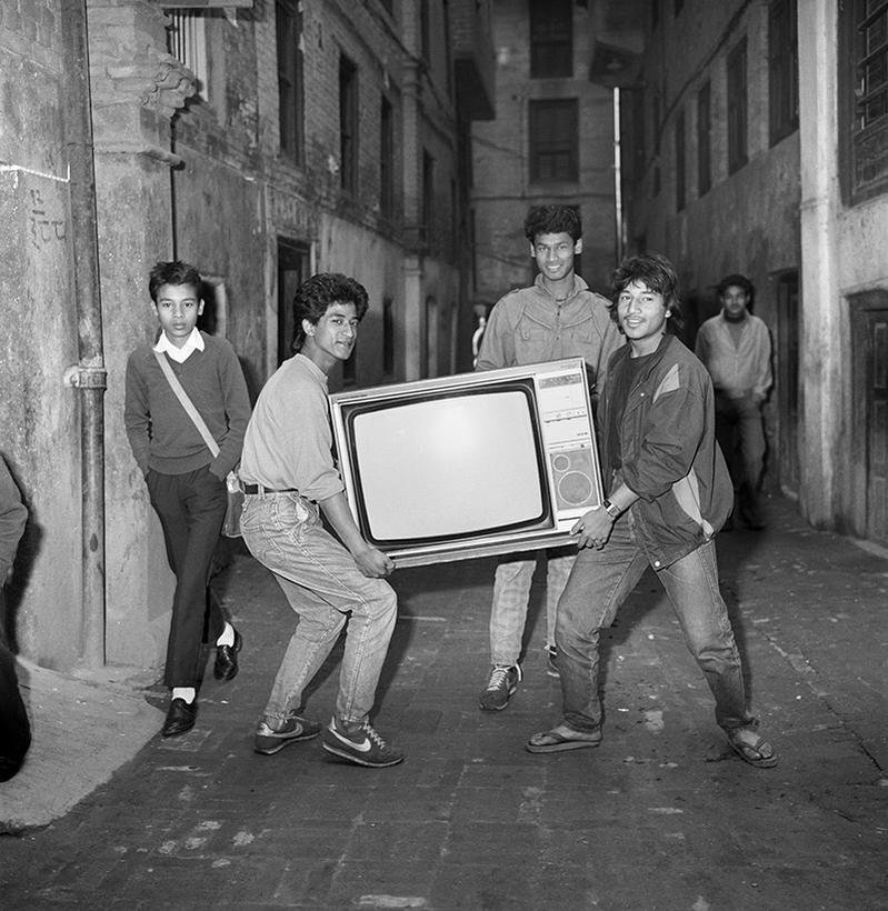 Young Newar men bringing home their first TV, in 1987. #Nepal
