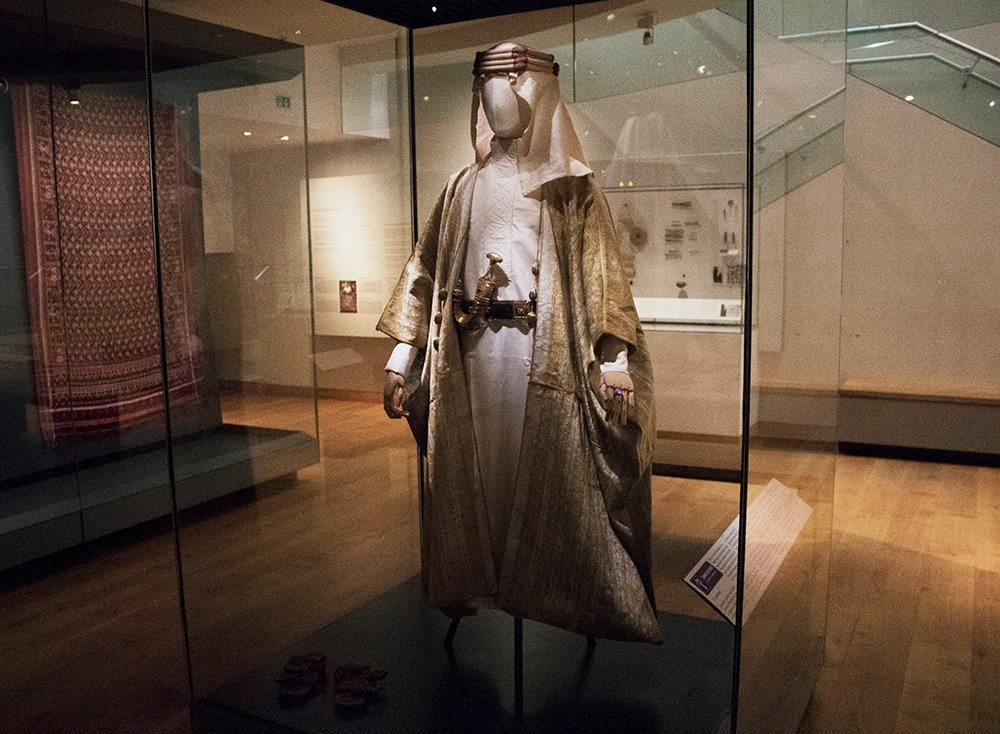T. E. Lawrence, also known as #LawrenceOfArabia, was born #onthisday in 1888. Robes worn by Lawrence while he was with the Arab army, along with his sandals, a gold ring set with a white sapphire, and a dagger (khanjar) with gold filigree handle, are on display in Gallery 5