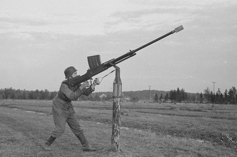 A Finnish soldier uses an anti-tank rifle as an anti