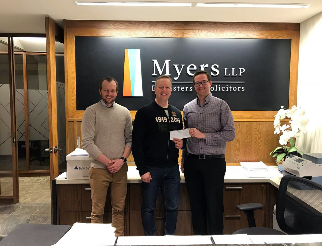 Greg Bartel and Joel Deeley from Myers LLP present Kevin Rebeck with cheque in the amount of $10,000.00, in support of the 1919 Winnipeg General Strike Centennial Anniversary celebrations.