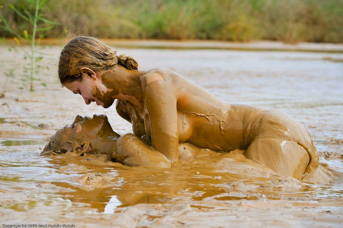 Naked teens play in the dark and messy mud
