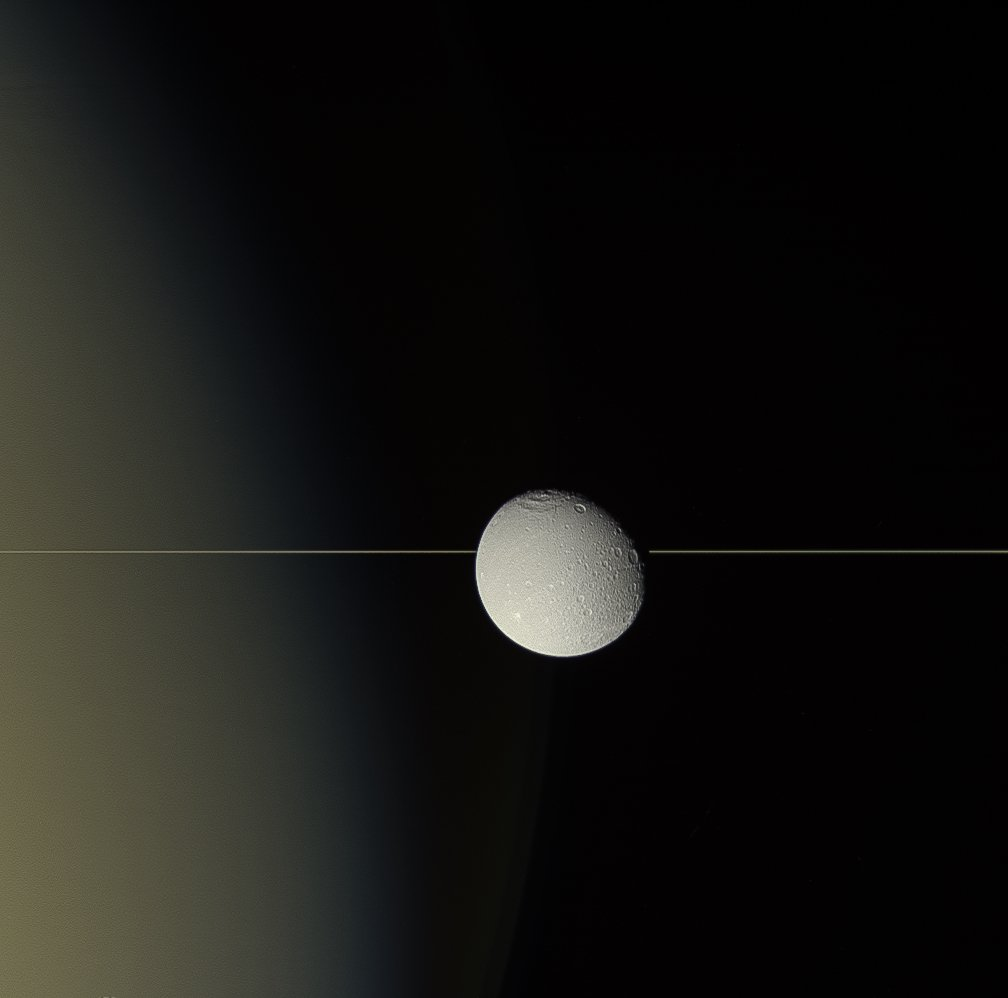 #OTD 17 August 2015, #Saturn's moon #Dione drifts before the planet's rings, seen here almost edge on. Natural-colour view by the international #Cassini mission's wide-angle camera 106 500 km from Dione @esascience @NASAhistory @ASI_spazio solarsystem.nasa.gov/resources/1782…