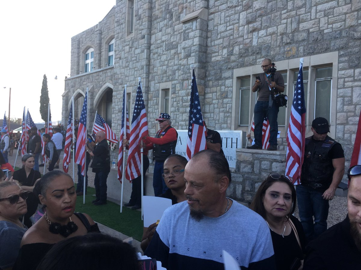 El Paso bikers, most of them veterans, form a flag line outside the prayer service for Margie Reckard. I've been struggling to describe what's happening tonight but several people I've talked to come back to this: El Paso is family.
