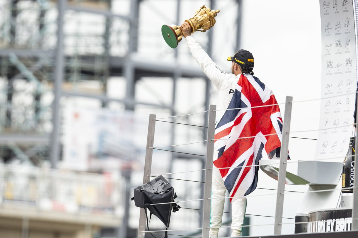 Holding the #BritishGP trophy up high   A true effort from @MercedesAMGF1 at one of their home races. Just 8.7 miles separate Silverstone from the team's home base in Brackley   #UBSF1<br>http://pic.twitter.com/9Q7zp2a5T5