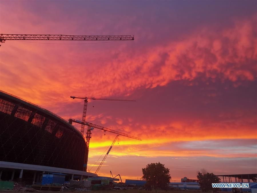 Photo taken on Aug. 15, 2019 shows the China-funded national stadium under construction during sunset in Phnom Penh, Cambodia. (Xinhua)