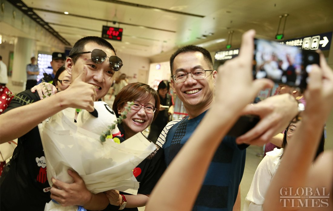 """Welcome home! Do you remember Global Times reporter #FuGuohao? When his hands were tied by rioters he said: """"I support #HongKong police, you can beat me now."""" After being brutally attacked in HK airport, he said he still loves Hon Kong. #香港"""