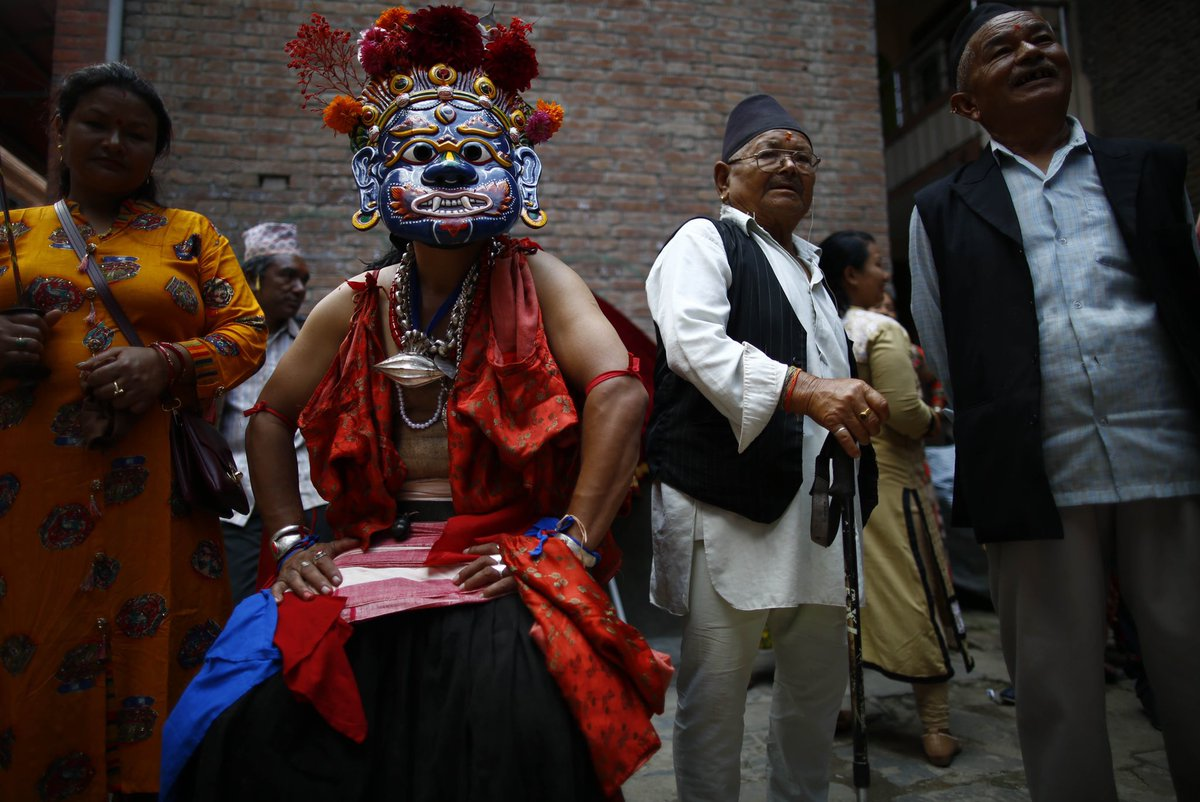 Masked dancers led by Bhairav and Ajimas take part in a traditional procession during Payo Jatra festival at Handigaun in Kathmandu, Nepal on Saturday, August 17, 2019.