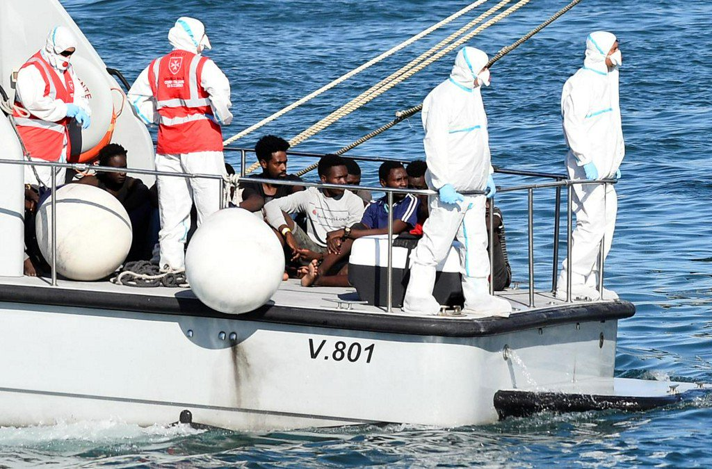 Spain offers port to stranded migrants, Italys Salvini claims victory reuters.com/article/us-eur…