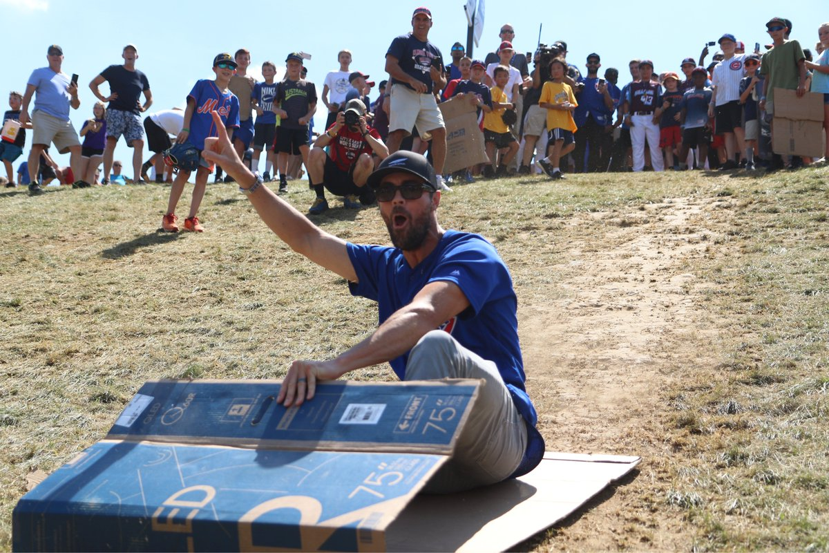 Cubs frolic before Little League Classic: Sledding, mingling and doing pushups