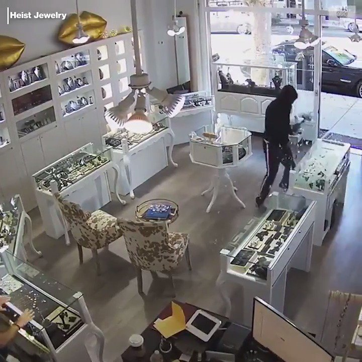 BRAZEN HEIST: Surveillance footage shows three suspects entering a Santa Monica jewelry store with one of them using a sledgehammer to smash a display case.The store's owner suffered minor injuries when he attempted to stop the thieves. https://abcn.ws/2z7rjjY