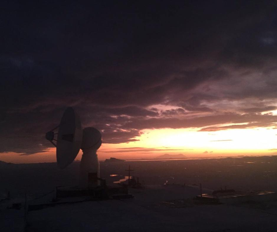 Dawn at OHiggins Station at the tip of the Antarctic Peninsula, with the 9m antenna dish of the German Antarctic Receiving Station (GARS OHiggins) @DLR_en; the view north into Bransfield Strait, Astrolabe Is on the horizon, pic Carlos Castillo Gómez @Ejercito_Chile @inach_gob