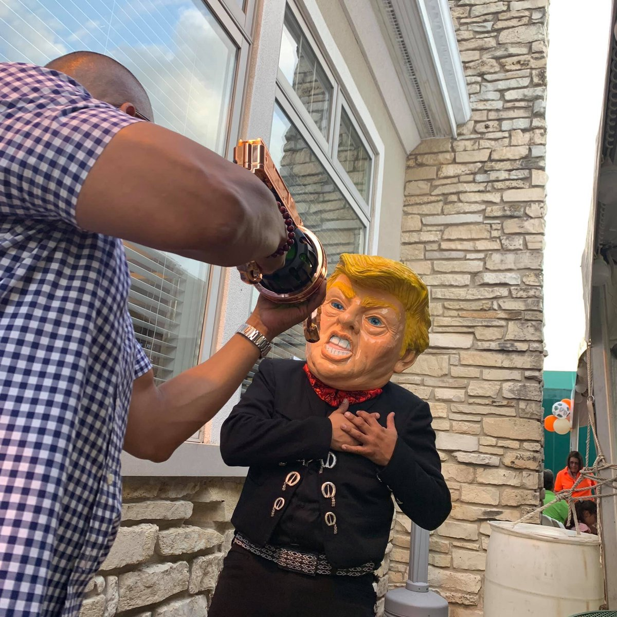 Shocking: A Democrat State Senator's fundraiser featured photo opportunities to point a fake rifle at someone dressed as @realDonaldTrump Every single Democrat running for president has been silent on this Do they all condone this encouragement of political violence? 🤔