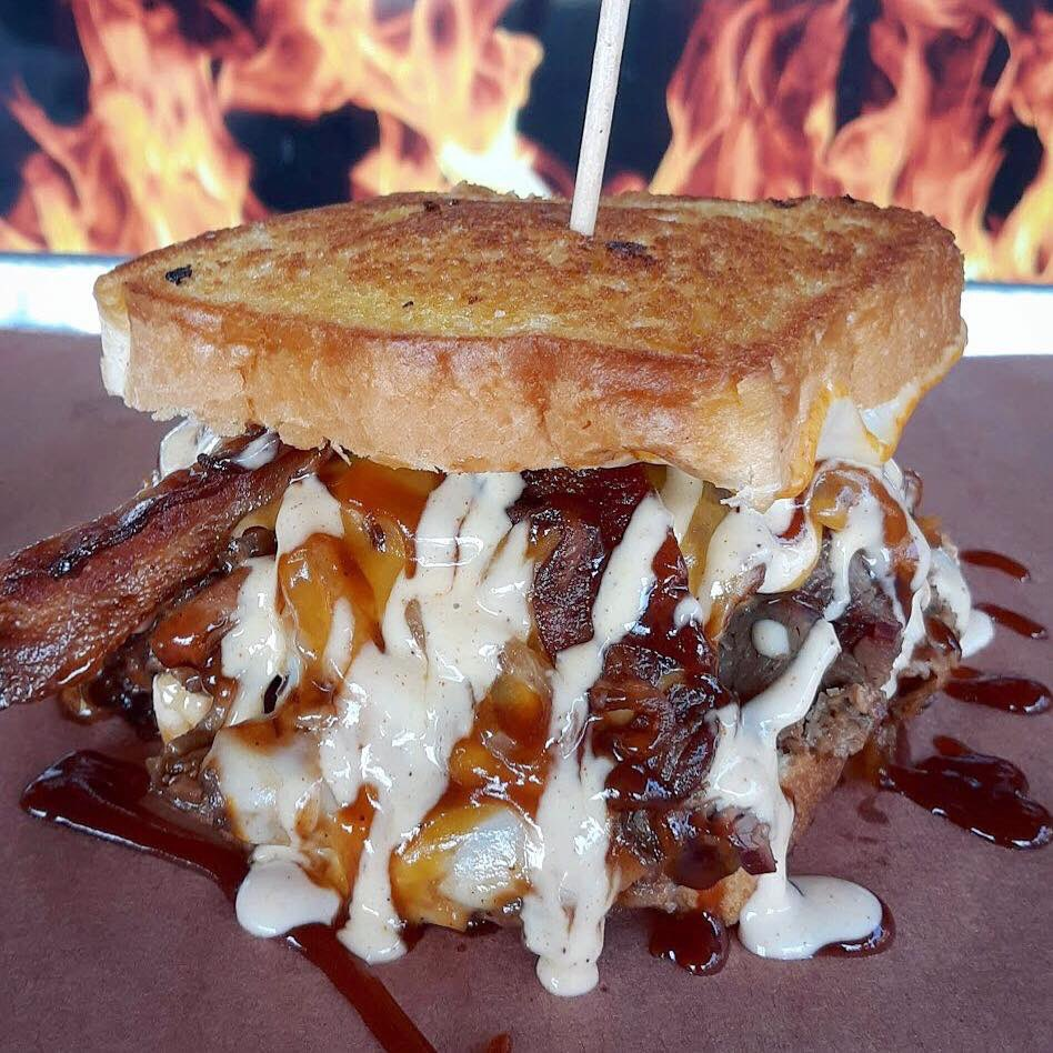 I'M MELTING! Beef Brisket, Caramelized Onions, Muenster-Provolone-Cheddar-Pepper Jack Cheeses, House Bacon, STL Sweet & White BBQ on Texas Toast. 🔥636-265-1234🔥