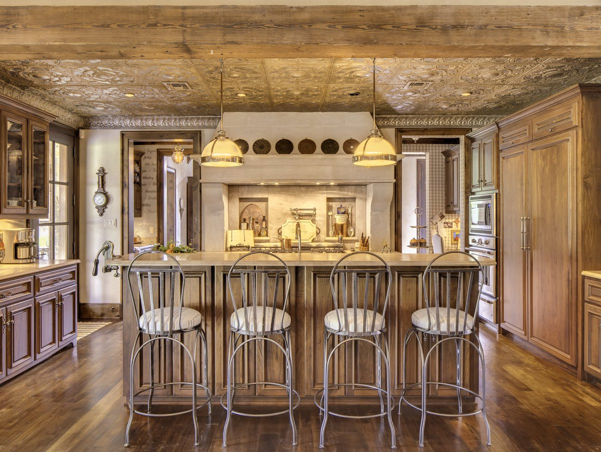 Look at this kitchen, many unique features such as antique tin ceiling, walnut cabinetry and a limestone vent hood.Designed Architect Jack Arnold, Interior Design Betty Lou Phillips, Limestone Hood Francois and Co, Cabinetry Custombilt, Limestone Countertops Natural Stone and Des <br>http://pic.twitter.com/hHG1OPnXg5