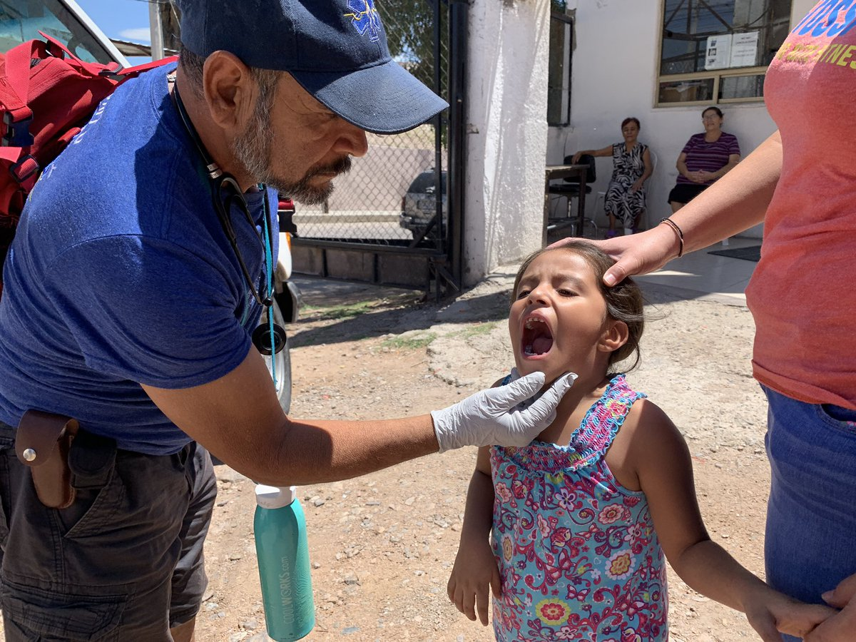 Pancho, a registered nurse from Voices from the Border volunteers brief checkups with migrant families waiting to seek asylum in Nogales Mexico. #MigrantJourney