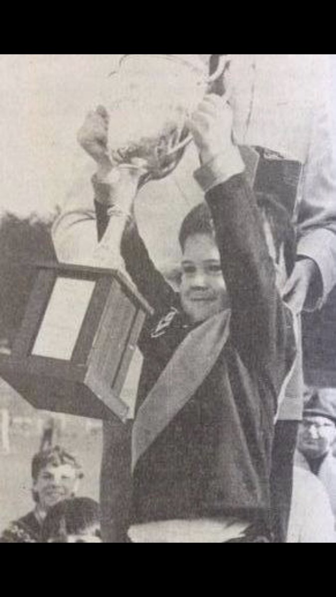 AFL legend Jonathan Brown aged three holds up the Colac-Coragulac Tigers premiership cup from the 1985 Hampden league grand final. Browns father Brian coached the Tigers to victory.