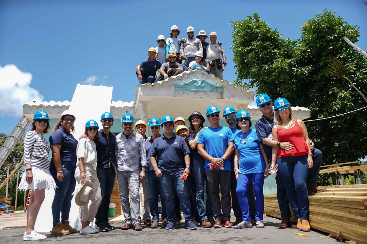 The volunteer group from @heart911 and @fordfund taking a break from a home repair in progress in Puerto Rico. Their leadership made it possible to put an entire new roof on this house in one week!
