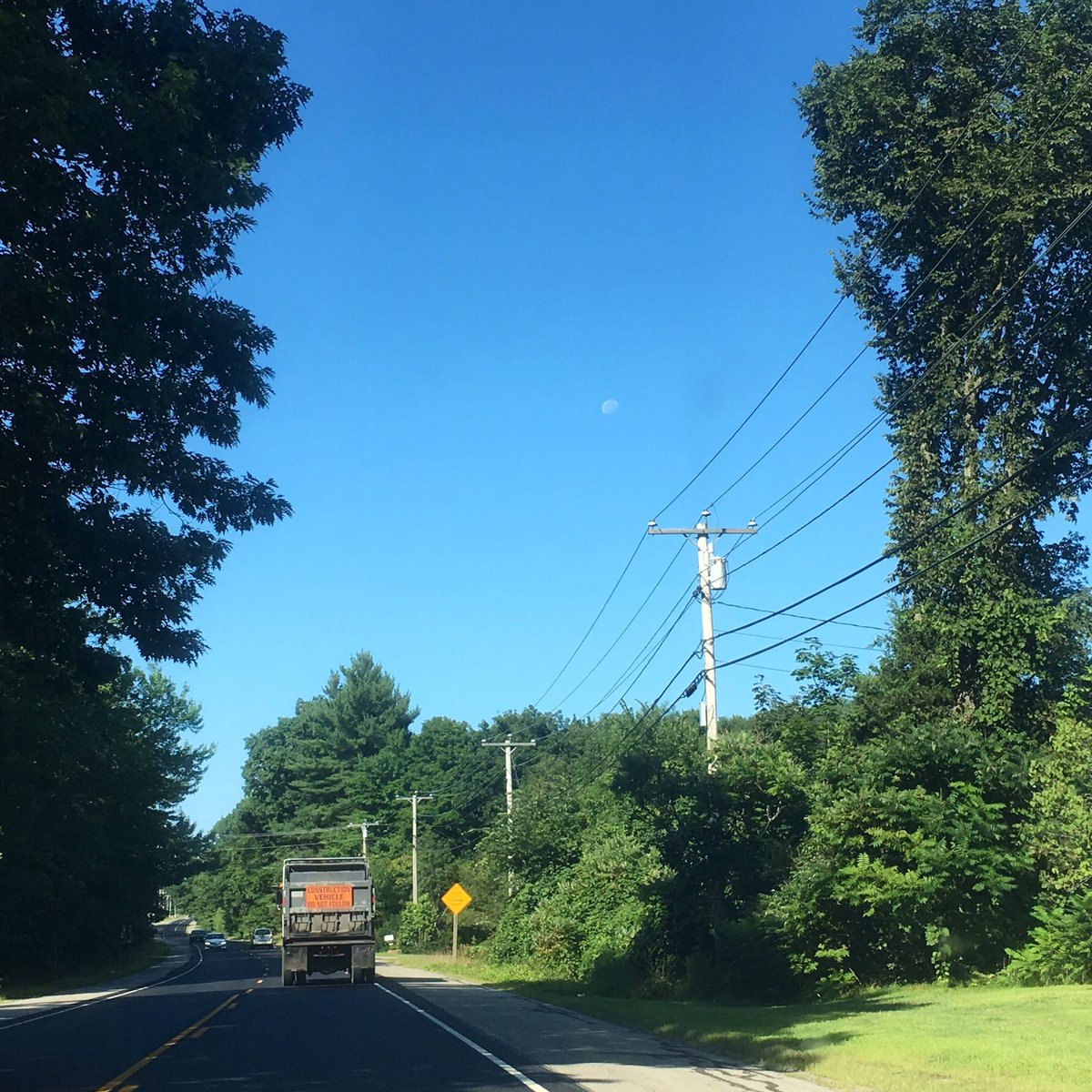 #Sick at work this morning, headed home to rest 🤢😷But first- #Dashcam photo of this gorgeous day... and I spy the #moon! 🌞🌝Enjoy today- #warm but less humid with #sunny skies. Muggy again tomorrow with thunderstorms on the way. #Tuesday #bluesky #maine #mewx #weather #wmtw