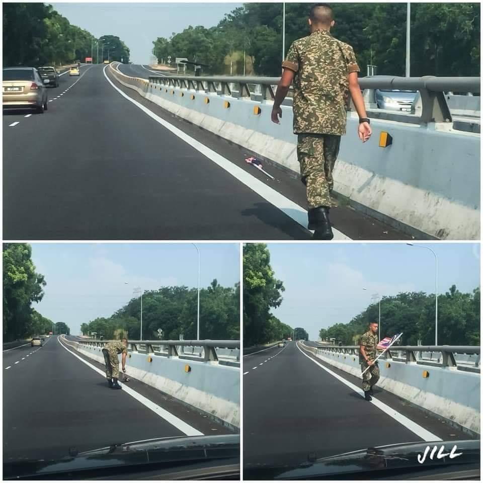 Seorang askar memberhentikan kenderaan untuk mengangkat bendera Malaysia yang terjatuh di jalanraya.  Hormati bendera kita. Hormati tentera kita.  Inilah wira negara! https://t.co/UMy2vVM7n2