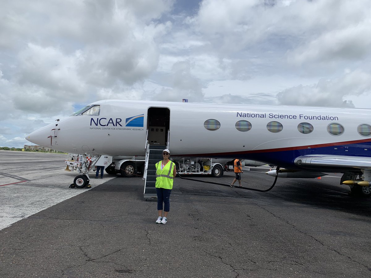 Lorena standing in front of the NSF/NCAR Gulfstream-V aircraft for the OTREC field campaign.