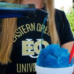 Cooling off in downtown La Grande with the best blue snow cone around!🍧💛💙#goEOU
