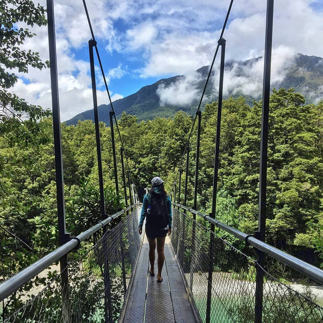 #MeetTheWorld: With views like this, you'll definitely want to cross this bridge when you come to it.Sulaing captured this great shot while on the delightful Blue Pools Track, a short 1hr return walk over the Makarora River on the South Island of New Zealand. 📸: @mammy_su
